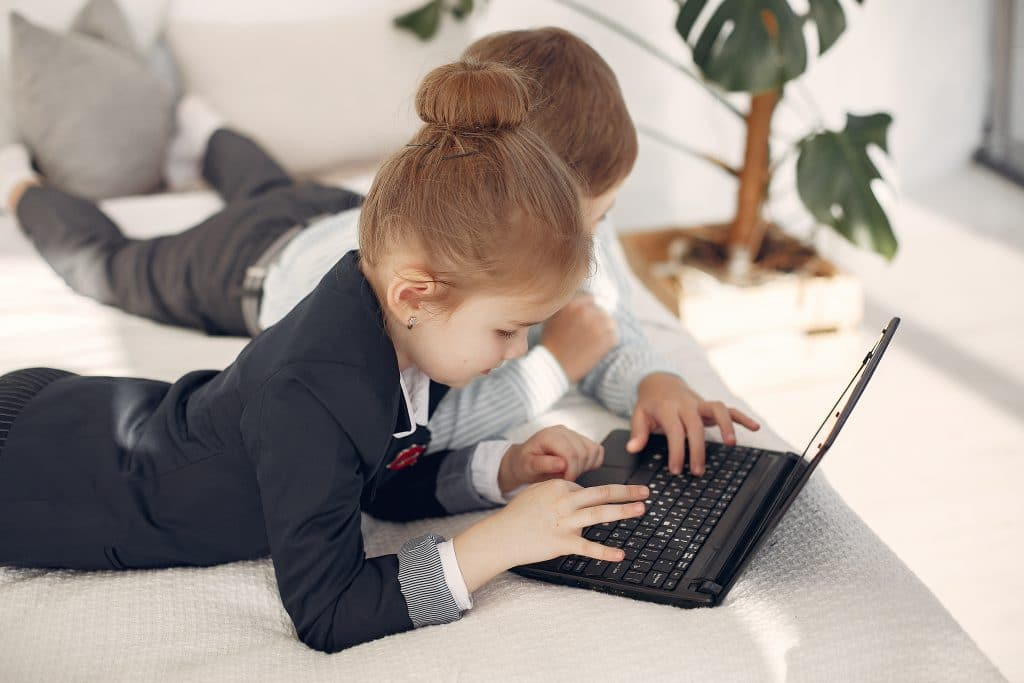 Online Consumer Shopping Habits and Behavior Statistics - Children Using Laptop